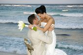 pic of wedding couple  - brige and groom celebrating on the beach - JPG