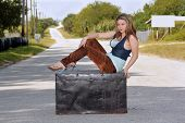 Teen Girl on a Trunk in the Street (1)