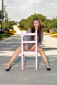 Teen Girl Sitting in a Chair in a Roadway (3)