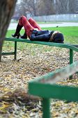 Girl Resting On A Bench