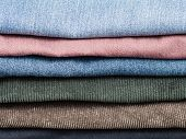 Stack Of Various Jeans And Corduroy Slacks poster