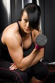 Asian woman lifting weights
