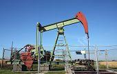 stock photo of nonrenewable  - small deep mining crude oil well in europe - JPG