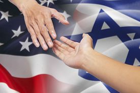 picture of israel people  - Hand pulling a person hand and giving a help in front of american and israel flags - JPG