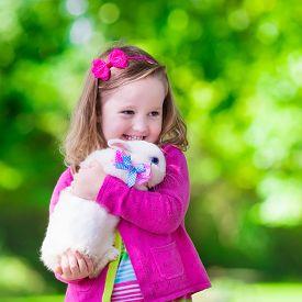 stock photo of bunny rabbit  - Children play with real rabbit - JPG