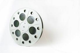 image of mm  - Big movie reel and 35 mm filmstrip - JPG