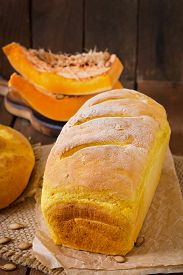 picture of fresh slice bread  - Fresh homemade pumpkin bread and pumpkin slices and olives - JPG