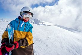 picture of snowboarding  - Portrait of woman snowboarder on background beautiful landscape of snowy high mountains of Caucasus at Krasnaya Polyana standing with snowboard - JPG