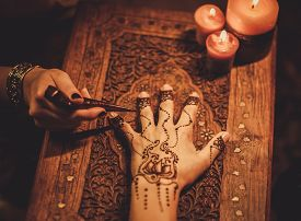 stock photo of vedic  - Drawing process of henna menhdi ornament on woman - JPG