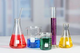 picture of beaker  - Laboratory flasks and beakers with liquids of different colors on lab table - JPG