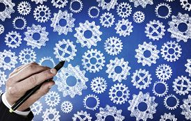 stock photo of mechanical drawing  - Close up of hand drawing gears mechanism with marker - JPG