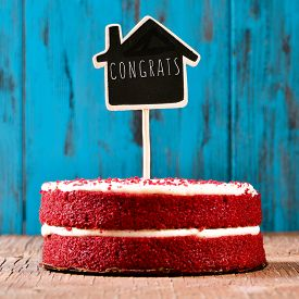 pic of red velvet cake  - a red velvet cake with a chalkboard in the shape of a house with the text congrats - JPG