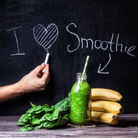 image of smoothies  - Fresh green smoothie with banana and spinach with title I love smoothie on blackboard - JPG