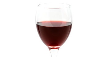 image of brindis  - a red wine cup on a white background half filled - JPG