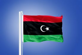 image of libya  - Flag of Libya flying against a blue sky - JPG