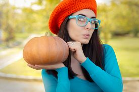 stock photo of beret  - Curious autumn girl with crocheted beret - JPG
