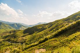 stock photo of denude  - Decimated deforestation mountains with the remnants of trees in Laos - JPG