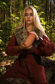 pic of rune  - Scandinavian witch pythoness with runes on a forest background - JPG