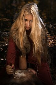 image of rune  - Scandinavian witch pythoness with runes on a forest background - JPG