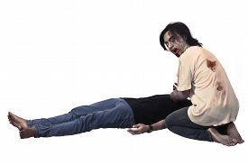 image of corpses  - Scary asian male zombie eating corpse isolated over white background - JPG