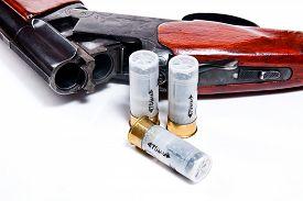 stock photo of shotgun  - Hunting shotgun and ammunition on white background - JPG
