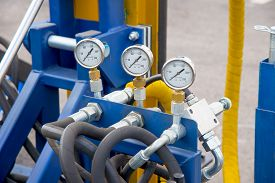 image of manometer  - Hydraulic tubes fittings and manometers on control panel of lifting mechanism - JPG