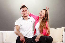 foto of fool  - Happy couple having fun and fooling around - JPG
