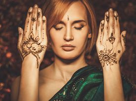 image of vedic  - Woman with traditional mehndi henna ornament  - JPG
