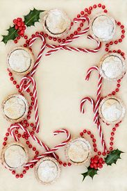 picture of candy cane border  - Christmas background border with homemade mince pie cakes - JPG
