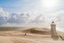 picture of sandstorms  - Sandstorm at the lighthouse Rubjerg Knude in North Jutland Denmark - JPG
