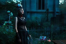 picture of wraith  - Woman with white eyes standing in a cemetery at night - JPG