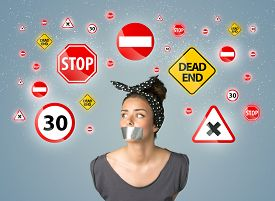 stock photo of traffic signal  - Young woman with taped mouth and traffic signals around her head - JPG