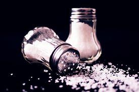 image of salt shaker  - Two glass salt shakers and salt black - JPG