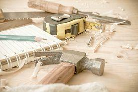 foto of chisel  - carpenter toolshammermeternailsshavings and chisel over wood table - JPG