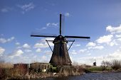The old Dutch windmills, Holland, rural expanses . Windmills, the symbol of Holland. Holland windmil poster