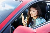Tensed Woman Talk On Phone Inside Car poster