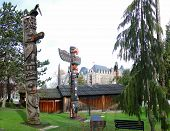 stock photo of indian totem pole  - Totem pole topped by thunderbird Thunderbird Park Victoria BC Canada - JPG