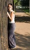 Woman Near A Fence