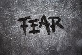 stock photo of horrific  - the word fear on grunge background  - JPG