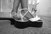 picture of stomp  - Girl in high heels stomps on a guitar - JPG