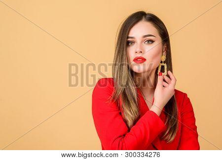 poster of Woman Wear Glamorous Earrings. Fashion Trend. Jewelry Shop. Girl Model Long Hair Demonstrating Golde