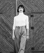 Woman Confidently Walk. Woman Fashionable Brunette Stand Outdoors Wooden Background. Fashion And Sty poster