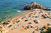 SANT POL DE MAR, SPAIN - AUGUST 17: La Roca Grossa Beach on August 17, 2011 in Sant Pol, Spain. The