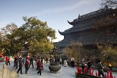 HANGZHOU, CHINA - NOVEMBER 26: Visitors and devotees throng the Mahavira Hall of Lingyin Temple on N