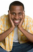 stock photo of teenage boys  - Young african american man head in hands - JPG