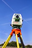 Total Station With Blue Sky In The Background. Survey Instrument Geodetic Device, Total Station Set  poster