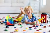 Kids Play With Toy Cars In White Room. Little Boy Playing With Car And Truck Toys. Vehicle And Trans poster