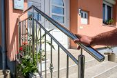 Chrome Fence On Staircase. Hand Holds Stainless Steel Fence poster