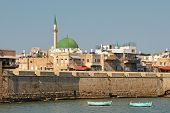 View on ancient walls, houses and mosques in old town of Acre (Akko) in Israel.