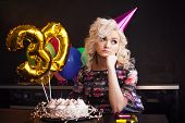 Anniversary Birthday. Young Beautiful Blonde Sitting In Front Of A Birthday Cake And Sad. Birthday,  poster